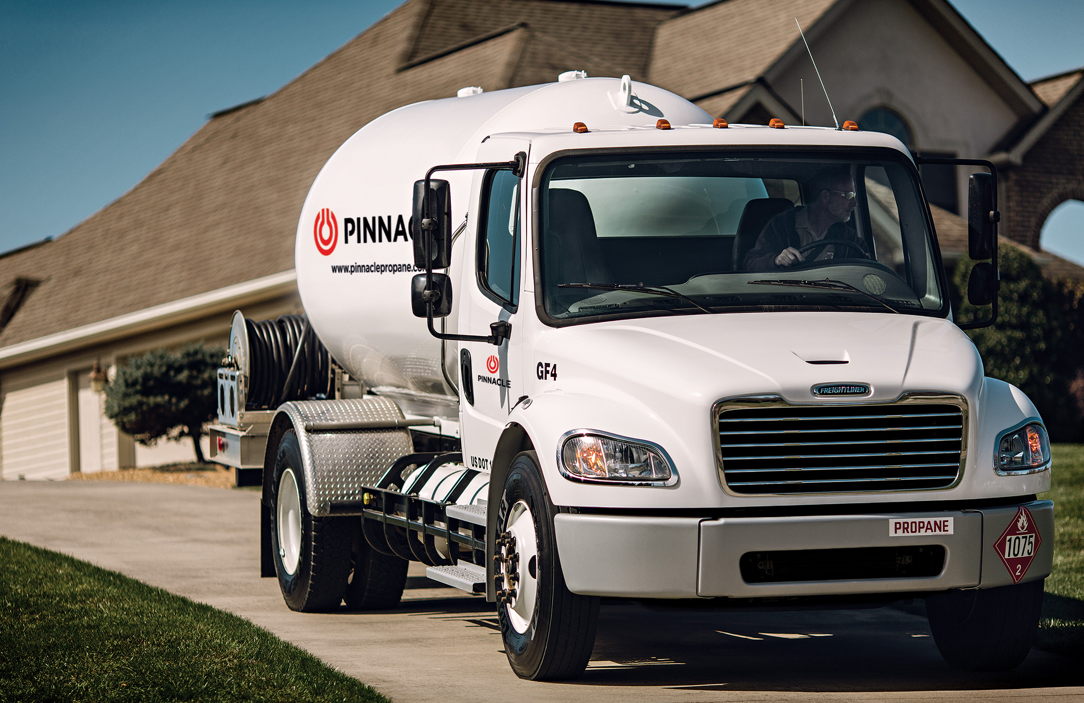 Propane bobtail truck in front of house